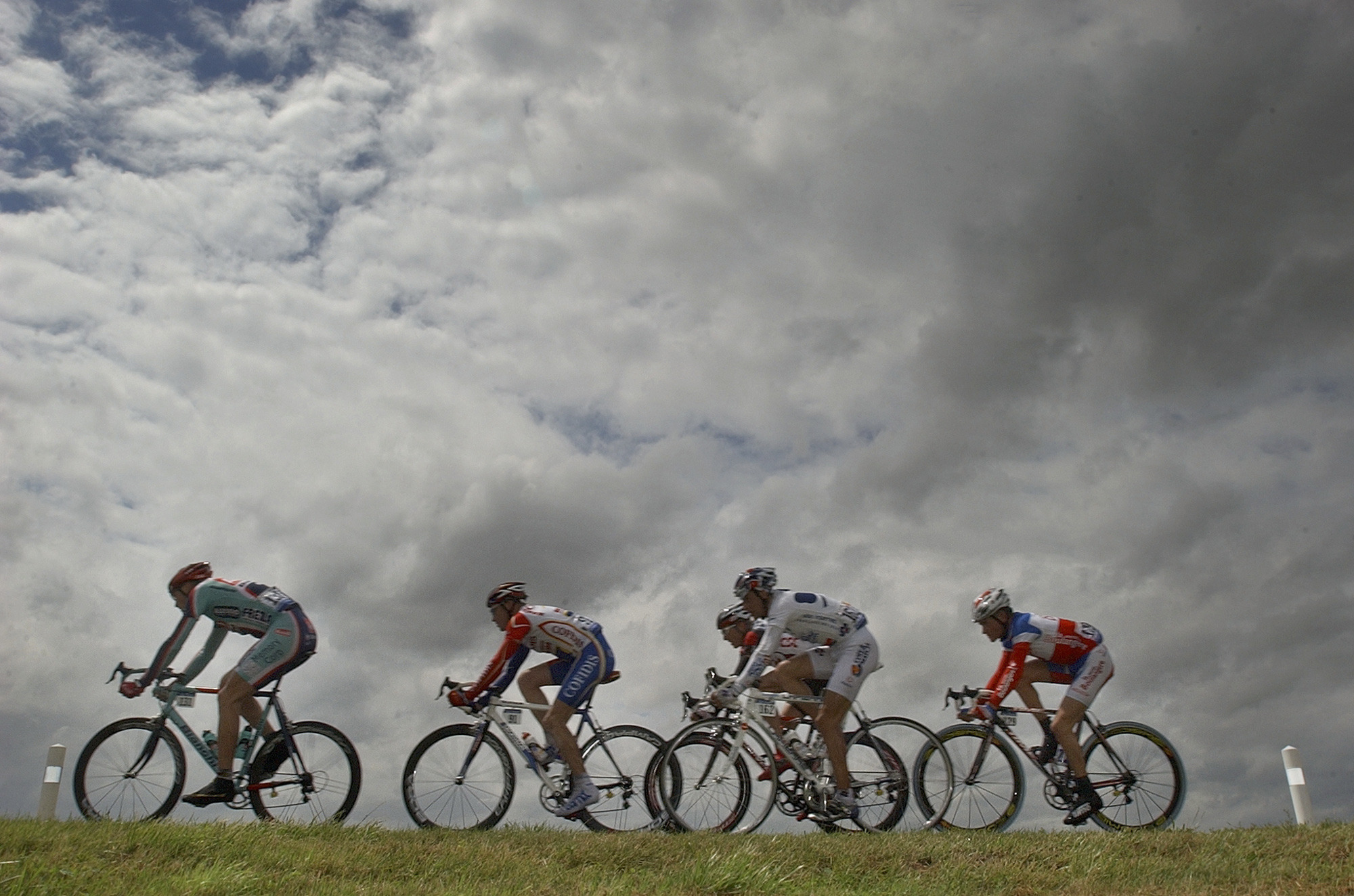The breakaway group with cyclists Magnus Backstedt of Sweden, left, Stuart O'Grady of Australia, second left, Sandy Casar of France, third from left front, Jakob Piil of Denmark, third from left rear, and Thomas Voeckler of France, pedal during the 5th stage of the Tour de France cycling race between Amiens, northern France, and Chartres, west of Paris, Thursday, July 8, 2004. O'Grady won the stage, Voeckler takes over the overall leader's yellow jersey. (AP Photo/Peter Dejong)