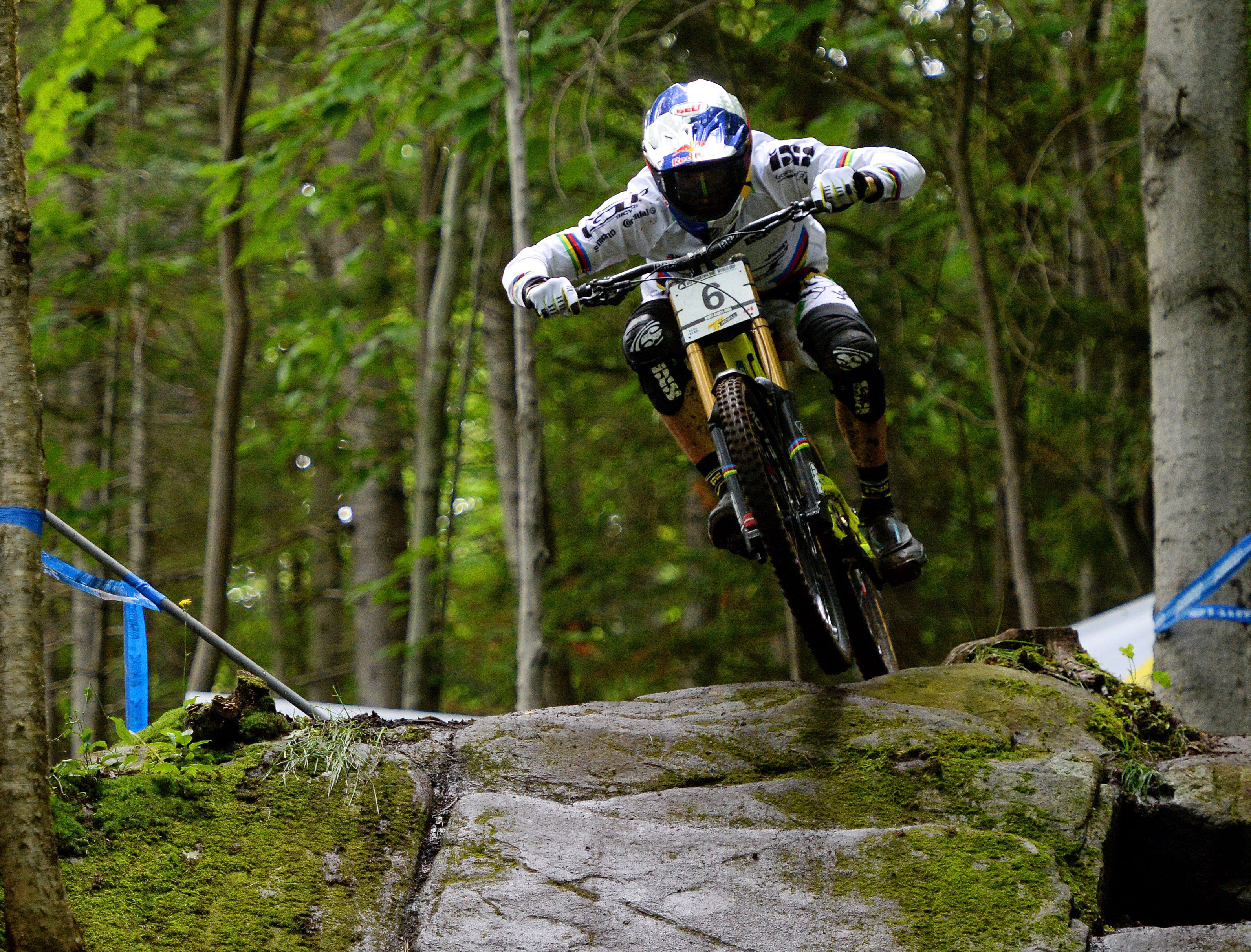 Gee Atherton of Great Britain races during the men's downhill at the UCI mountain bike world cup at Mont-Sainte-Anne in Beaupre, Quebec, on Saturday, Aug. 1, 2015. This is the 25th consecutive year the Mountain Bike World Cup has been held at Mont-Sainte-Anne. (Sean Kilpatrick/The Canadian Press via AP)