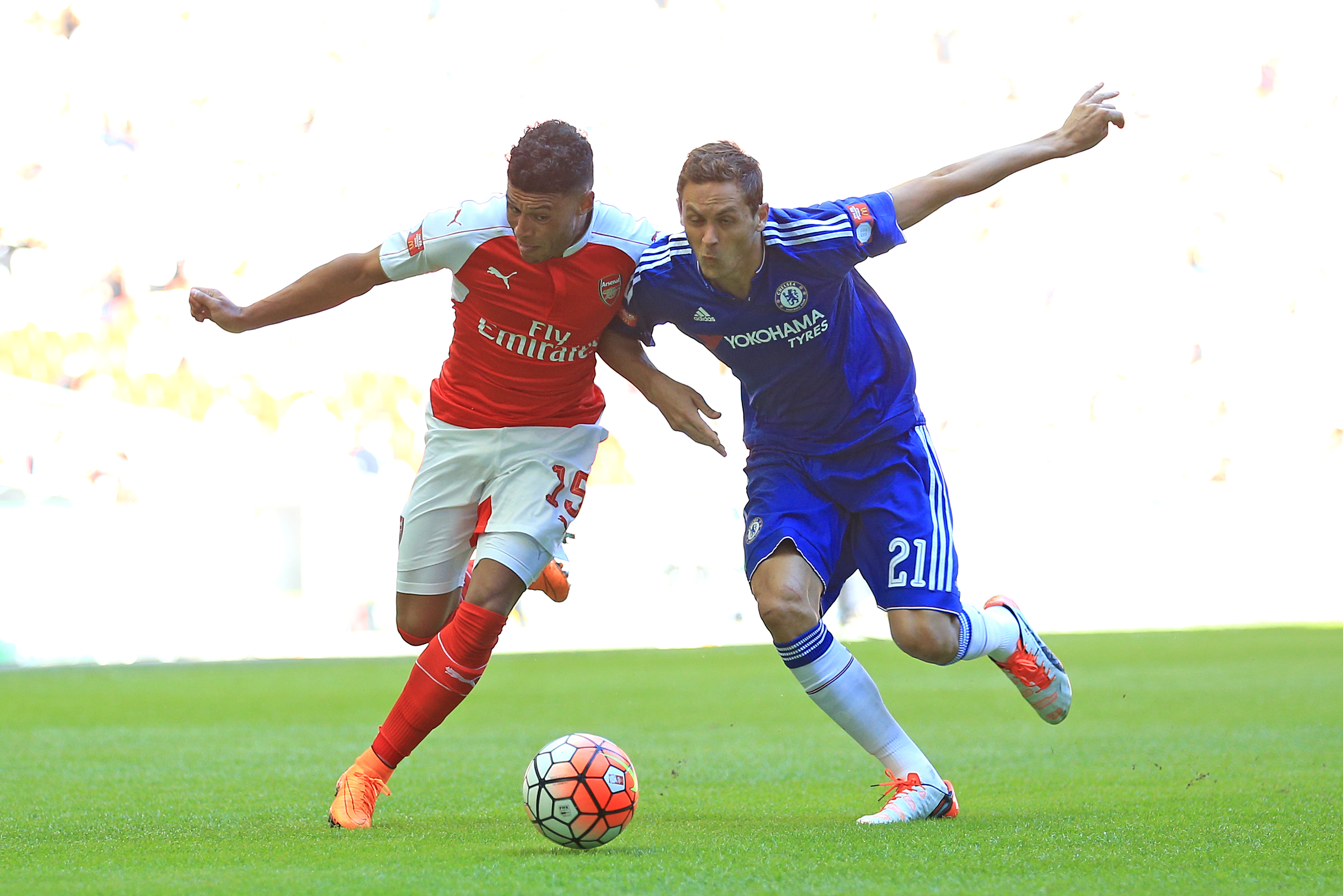 Arsenal's Alex Oxlade-Chamberlain (left) and Chelsea's Nemanja Matic battle for the ball during the FA Community Shield at Wembley Stadium, London.